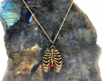 Bronze lung with coral orb necklace
