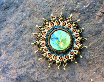 Macrame mandala with Labradorite gemstone. Sun shape jewelry in boho chic style. Eco-friendly, conscious, vegan accessories
