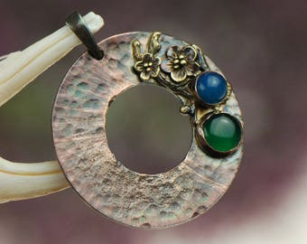A copper circle with agates in flowers, c 582, copper flowers, with agate,
