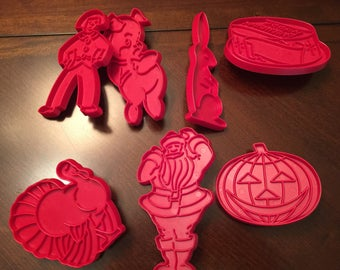7 Vintage Tupperware Red Cookie Cutters
