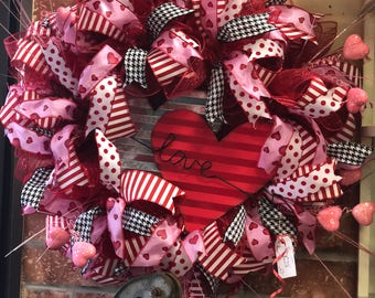 Beautiful Valentine Mesh Wreath with Cupid's arrow.