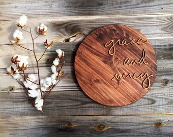 grace and mercy hand made wood piece
