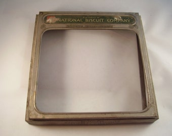 """Antique National Biscuit Company metal lid/cover - Pat. 1923 - """"Uneeda Bakers"""""""