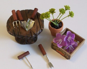 Fairy or gnome Garden miniature wood look table and gardening tools
