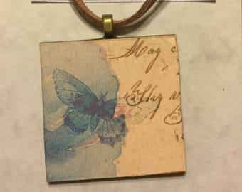 A sweet blue butterfly pendant.