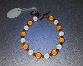 Orange and white beaded bracelet
