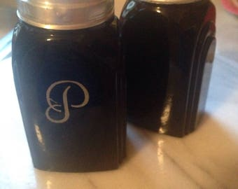 Vintage McKee black glass salt and pepper shakers