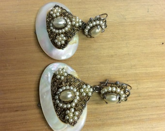Ornamental mother of pearl and ornate metal earrings