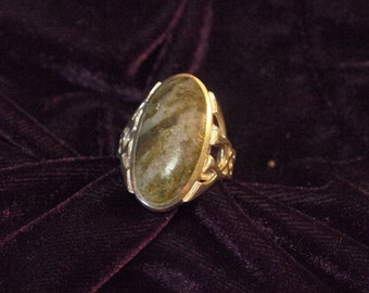 Large Celtic Design Accented Ring with Mottled Green Stone