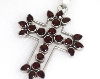 Large sterling silver cross with faceted garnet