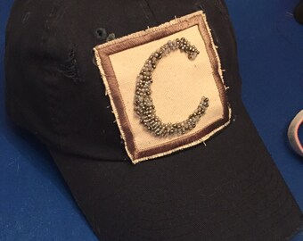 Distressed baseball hat with hand sewn beaded initial patch