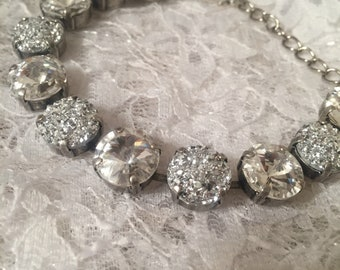 12mm crystal clear Swarovski crystals and white druzy in between.
