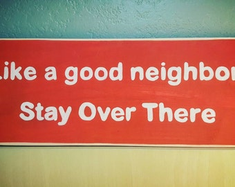 Humorous wooden sign, Neighbor gift, Like a good neighbor stay over there, Parody insurance slogan, Hand painted sign, House door sign red