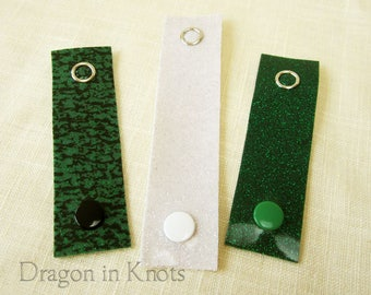 Serpentine Cord Clips - Set of 3 Glitter Cord Wraps in Green and White Silver Vinyl, Reusable Snap Cable Ties, Colorcoded Organization