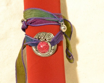 Bracelet by wrapping with tape hand-painted silk and metal charms