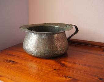 Antique copper pot.