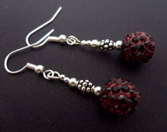 A pair of pretty burgundy red  shamballa style dangly earrings.