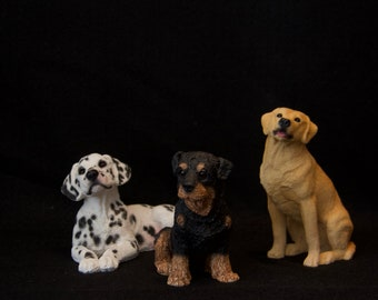 Assortment of Resin Dogs, Dalmation, Yellow Lab, and Rottweiler puppy