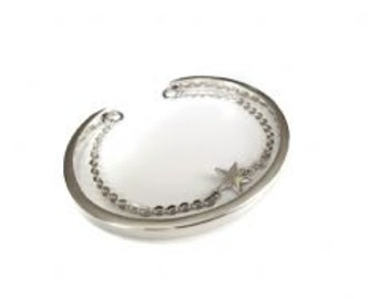 2 in 1 Torque Bangle with star charm bracelet attached.