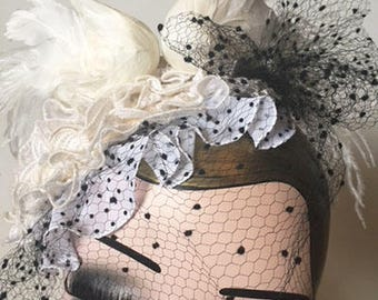Headpiece with two loving swans, lots of lace ruffles and delicate vintage veiling