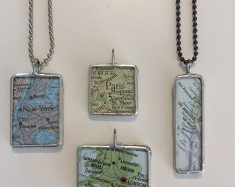 CUSTOMIZE A MAP PENDANT. Choose your destination,shape and color chain. Made from vintage World Atlases.