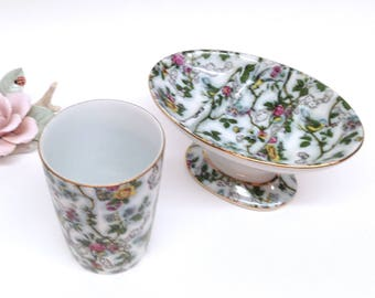 BATH VANITY SET is a Glazed Irice Chintz Design on a White Porcelain Pedestal Soap Dish and Cup w/Pattern of Birds & Flowers Trimmed in Gold