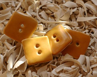 1 set of 4 square buttons saffron yellow