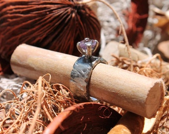 silver ring with rough coarse crude surface with amethyst starfacet