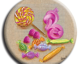 Magnet magnet representative of candy, a round lollipop and marshmallows on background linen in 38 mm