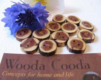 """Twelve wood buttons homemade made from Juniper wood 1/2"""" diameter."""
