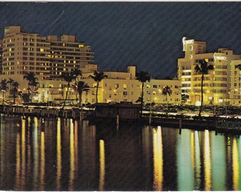 Vintage Miami Beach 1978 Postcard Night Scene of Hotels Along Renown Indian Creek