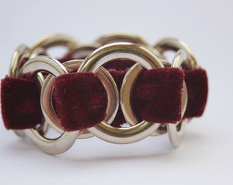 Red strechy velvet bracelet with metal rings that is unbreakable and adjusts to all sizes