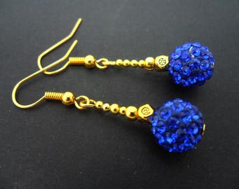 A pair of pretty gold colour blue shamballa bead style dangly earrings.