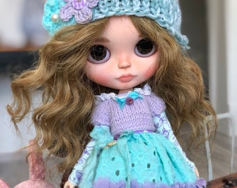 knitted hat with flowers and top with a collar
