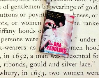 The Bra Peddlers - Book Pendant