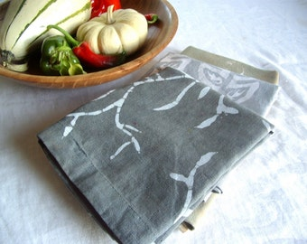 dark gray linen tea towel. printed with vines