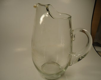 Tall clear glass pitcher with handle