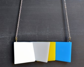 Abstract Geometric Perspex Squares Necklace - White, Grey, Yellow and Blue blocks