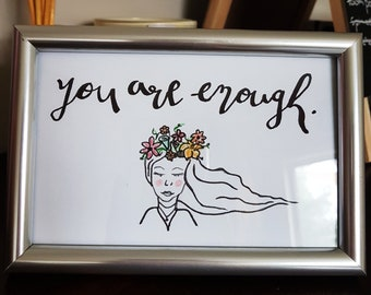 You are enough, hand lettered and illustrated.