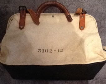 Gun bag 12x14. Made in USA- great to use as a handbag. Very chic and not heavy. Though not in pristine condition.