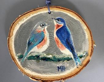 Bluebirds on birch slice