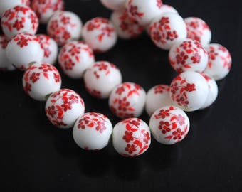 2 FLOWERS RED 10MM CERAMIC BEADS.
