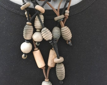 Necklace made of ceramic Beads in the spirit of the Neolithic