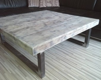 Industrial chunky metal and solid wood coffee table.