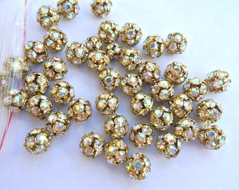 2 Vintage SWAROVSKI BEADS 10mm, AB crystals in brass setting creating ball bead