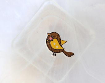 button wood Brown and yellow bird