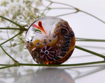 Lentil Focal Glass Bead with a Flower.