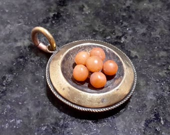 This is a stunning quality antique victorian 15ct yellow gold coral locket pendent