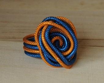 Spiral statement ring blue and orange wire
