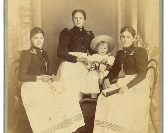 Occupational Cabinet card of Victorian domestic help posed with child holding toy horse. Maid. Seamstress. Governess.